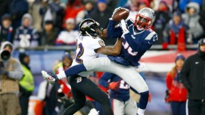 FOXBORO, MA - JANUARY 10: Duron Harmon #30 of the New England Patriots intercepts a pass late in the game during the 2015 AFC Divisional Playoffs game against the Baltimore Ravens at Gillette Stadium on January 10, 2015 in Foxboro, Massachusetts.   Jared Wickerham/Getty Images/AFP