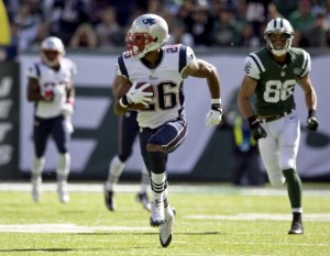 EAST RUTHERFORD, NJ - OCTOBER 20: New England Patriots player Logan Ryan heads to the end zone after an interception against the New York Jets during first quarter action at MetLife Stadium on Sunday, Oct. 20, 2013. (Photo by Matthew J. Lee/The Boston Globe via Getty Images)
