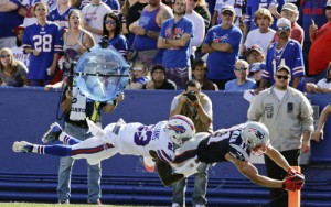 Buffalo Bills free safety Aaron Williams (23) tackles New England Patriots wide receiver Julian Edelman (11) in the end zone during the second half of an NFL football game Sunday, Sept. 20, 2015, in Orchard Park, N.Y. Williams was injured on the play as Edelman scored. (AP Photo/Bill Wippert)